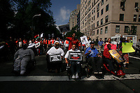 "protesters from civil rights groups walked during a silent march to end the ""stop-and-frisk"" program in New York June 17, 2012.  Photo by Kena Betancur / VIEWpress.."
