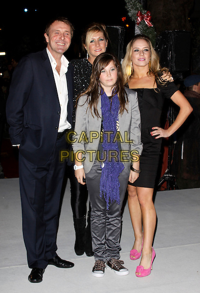 """PHIL TUFNELL, wife DAWN TUFNELL, daughter POPPY & KATYA VIRSHILAS.attending the World Premiere of Disney's """"A Christmas Carol"""", Odeon Leicester Square, London, England, UK,.November 3rd 2009..full length family father dad husband black dress navy suit pink shoes hand on hip navy in pocket.CAP/AH.©Adam Houghton/Capital Pictures."""