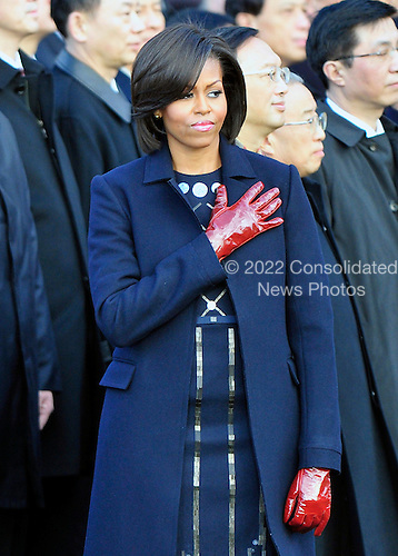 First lady Michelle Obama holds her hand over her heart as the National Anthem plays as she and United States President Barack Obama welcomes President Hu Jintao of China to the White House for a State Visit on Wednesday, January 19, 2011. .Credit: Ron Sachs / CNP.(RESTRICTION: NO New York or New Jersey Newspapers or newspapers within a 75 mile radius of New York City)