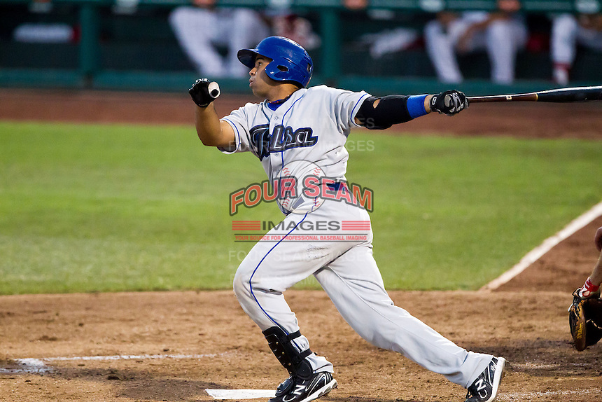 Wilin Rosario (20) of the Tulsa Drillers follows through his swing during a game against the Springfield Cardinals at Hammons Field on July 20, 2011 in Springfield, Missouri. Springfield defeated Tulsa 12-1. (David Welker / Four Seam Images)