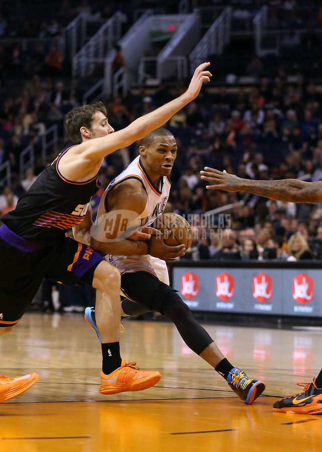 Feb. 10, 2013; Phoenix, AZ, USA: Oklahoma City Thunder point guard Russell Westbrook (0) drives to the basket against Phoenix Suns point guard Goran Dragic (1) at the US Airways Center. Mandatory Credit: Mark J. Rebilas-