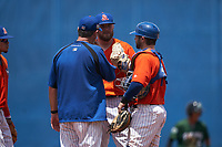 St. Lucie Mets pitching coach Mike Cather (left) talks with pitcher Thomas McIlraith (15) and catcher Mitch Ghelfi (11) during a Florida State League game against the Daytona Tortugas on August 11, 2019 at First Data Field in St. Lucie, Florida.  Daytona defeated St. Lucie 7-4.  (Mike Janes/Four Seam Images)