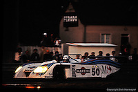LE MANS, FRANCE: The Lancia Martini LC1 001003 driven by Hans Heyer, Riccardo Patrese and Piercarlo Ghinzani approaches the Ford Chicane during the 24 Hours of Le Mans at Circuit de la Sarthe on June 20, 1982, in Le Mans, France.