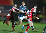 Scarlets outside half Aled Thomas tackles Munster full back Simon Zebo.<br /> Celtic League<br /> Scarlets v Munster<br /> <br /> 01.03.14<br /> <br /> ©Steve Pope-SPORTINGWALES