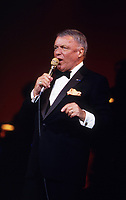 Chicago, Illinois, USA, September 10, 1986 <br /> Frank Sinatra performs at the reopening of the Chicago Theater. The reopening marked the culmination of a four-year preservation effort at a cost of 18 million dollars which left the current seating capacity of the theatre at 3,600. the gala reopening was symbolic because Sinatra had performed at the theatre in the 1950's. Credit: Mark Reinstein/MediaPunch