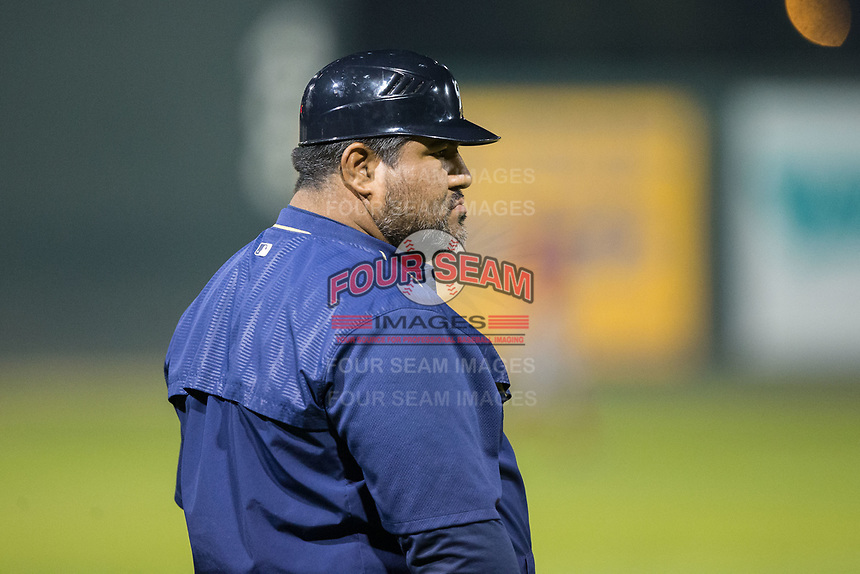 Helena Brewers manager Nestor Corredor (9) coaches third base during the game against the Orem Owlz at Kindrick Legion Field on August 17, 2017 in Helena, Montana.  The Owlz defeated the Brewers 5-2.  (Brian Westerholt/Four Seam Images)