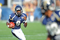 9 October 2010:  FIU running back Kedrick Rhodes (9) carries the ball in the second quarter as the FIU Golden Panthers defeated the Western Kentucky Hilltoppers, 28-21, at FIU Stadium in Miami, Florida.