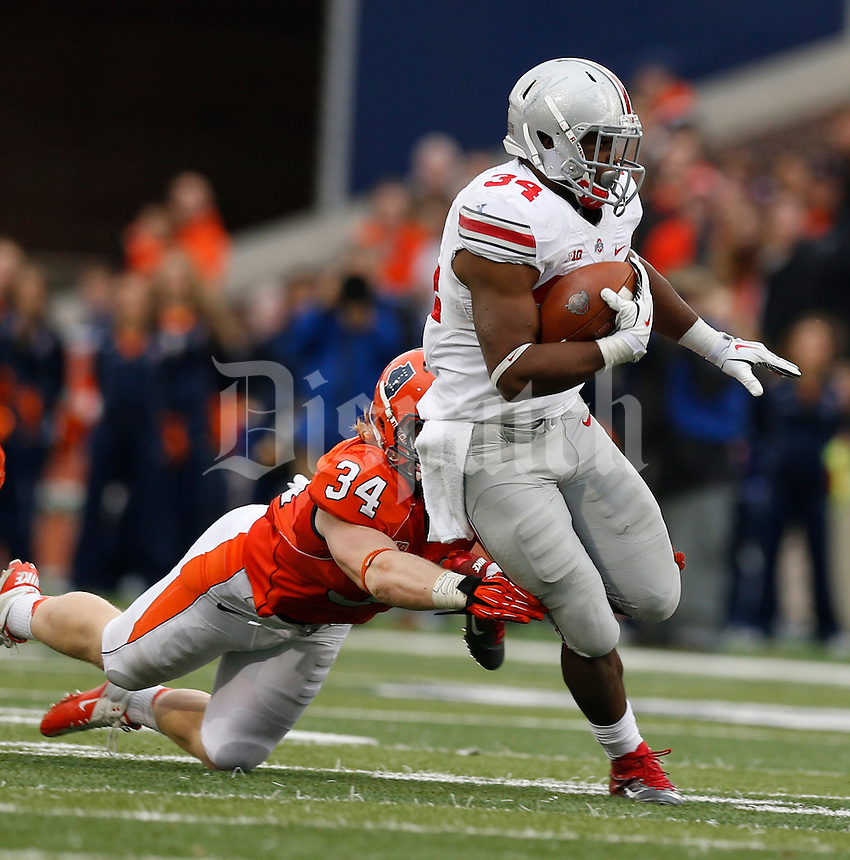 Illinois Fighting Illini linebacker Mike Svetina (34) dives for Ohio State Buckeyes running back Carlos Hyde (34) during the second half of Saturday's NCAA Division I football game at Memorial Stadium in Champaign, Il., on November 16, 2013. Ohio State won the game 60-35. (Barbara J. Perenic/The Columbus Dispatch)