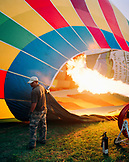 SRI LANKA, Asia, man operating a flame to fill a hot-air balloon