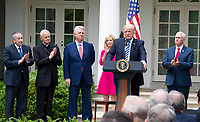 "United States President Donald J. Trump makes remarks prior to signing a Proclamation designating May 4, 2017 as a National Day of Prayer and an Executive Order ""Promoting Free Speech and Religious Liberty"" in the Rose Garden of the White House in Washington, DC on Thursday, May 4, 2017.  From left to right: Rabbi Marvin Hier, president Simon Wiesenthal Center; Cardinal Donald Wuerl, the archbishop of Washington; Pastor Jack Graham; Pastor Paula White of Floridaís New Destiny Christian Center; President Trump; US Vice President Mike Pence. Photo Credit: Ron Sachs/CNP/AdMedia"