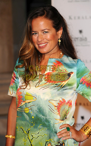 JADE JAGER .Attending Your Moment Is Waiting - launch party at Saatchi Gallery, London, England. September 21st 2010 .half length safari jungle animal print tunic dress hand on hip green ring rings bracelet smiling .CAP/CJ.©Chris Joseph/Capital Pictures.