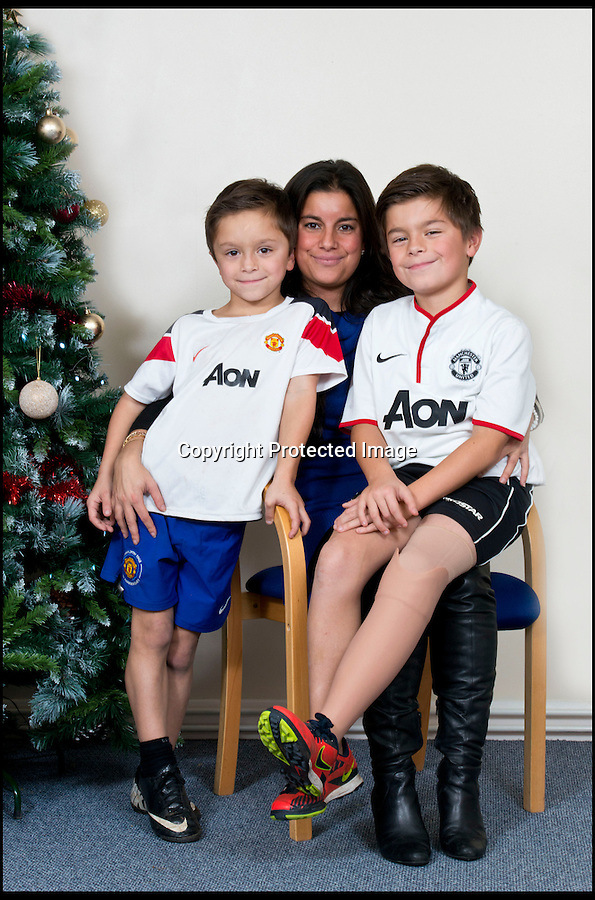 BNPS.co.uk (01202 558833)<br /> Pic: RachelAdams/BNPS<br /> <br /> Leon Meal-Moss with brother Marcel (6) and mum Katell Meal. <br /> <br /> Perfect gift for Xmas...A Footy nut can join in with the rest of his team for the first time this Xmas after receiving a revolutionary new prosthetic leg that  looks and feels just like an ordinary limb.Leon Meal-Moss, aged 10, had to have his lower left leg amputated when he was just eight-months-old after being born with severe deformities.The plucky youngster learnt to walk using rigid NHS false limbs which he found painful and was forced to swing his leg sideways.The schoolboy, who is a keen sports fan, was sponsored by his local football club and was bought a top-of-the-range false leg that enabled him to run in his PE classes.