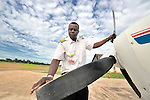 Gaston Ntambo, a United Methodist missionary, inspects the prop of a Cessna P210 at an airstrip in Kamina in the Democratic Republic of the Congo. Ntambo and the plane are part of the Wings of the Morning aviation ministry of The United Methodist Church, and provide life-saving access to isolated rural communities.