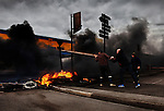 Striking fisherman, protesting about the low price of fish, block the main road artery in the port&rsquo;s fish processing district, Cap&eacute;cure, with burning tyres. Boulogne-sur-Mer, France.<br />