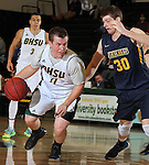 SPEARFISH, SD - JANUARY 8, 2016 -- Wyatt Krogman #11 of Black Hills State drives past Ryan Beisty #30 of Regis during their college basketball game Friday at the Donald E. Young Center in Spearfish, S.D. (Photo by Dick Carlson/Inertia)