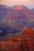 The setting sun casts a warm glow across the Grand Canyon near Yaki Point.