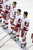 Andrew Joudrey 24, Michael Davies 9 and Jake Dowell 11 of the University of Wisconsin line up for the anthem. The Boston College Eagles defeated the University of Wisconsin Badgers 3-0 on Friday, October 27, 2006, at the Kohl Center in Madison, Wisconsin in their first meeting since the 2006 Frozen Four Final which Wisconsin won 2-1 to take the national championship.<br />
