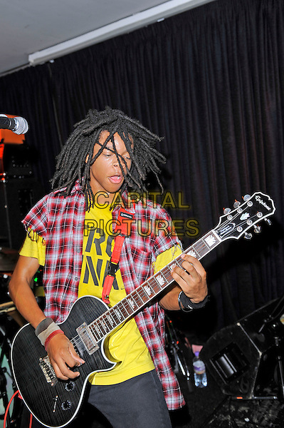 Dee Radke of Radkey <br /> performing in concert, The Blackeart, Camden, London, England. <br /> 17th October 2013<br /> on stage in concert live gig performance performing music half length red check shirt yellow top guitar     <br /> CAP/MAR<br /> &copy; Martin Harris/Capital Pictures