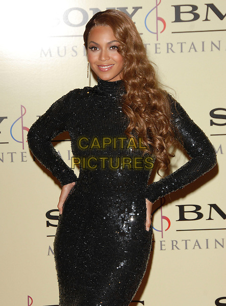 BEYONCE KNOWLES.attends The Sony / BMG Post Grammy Party held at The Beverly Hills Hotel in Beverly Hills, California, USA, February 11 2007..half length black dress sequined polo neck long sleeved  hands on hips .CAP/DVS.©Debbie VanStory/Capital Pictures