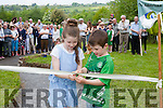 Young Parishioners Jack & Chloe Harnett cutting the ribbon to officially open the 1916 Commemorative Garden.