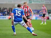 Lincoln City's Danny Rowe vies for possession with Macclesfield Town's Ben Stephens<br /> <br /> Photographer Andrew Vaughan/CameraSport<br /> <br /> The EFL Sky Bet League Two - Lincoln City v Macclesfield Town - Saturday 30th March 2019 - Sincil Bank - Lincoln<br /> <br /> World Copyright © 2019 CameraSport. All rights reserved. 43 Linden Ave. Countesthorpe. Leicester. England. LE8 5PG - Tel: +44 (0) 116 277 4147 - admin@camerasport.com - www.camerasport.com