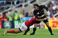 Ma'a Nonu of New Zealand is tackled in possession. Rugby World Cup Pool C match between New Zealand and Tonga on October 9, 2015 at St James' Park in Newcastle, England. Photo by: Patrick Khachfe / Onside Images