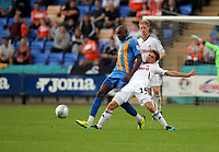 Pictured L-R: Marvin Morgan of Shrewsbury tackled by Joe Allen of Swansea. Tuesday 23 August 2011<br />