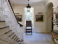 The staircase hall is at the centre of the house and has a smooth flagstone floor