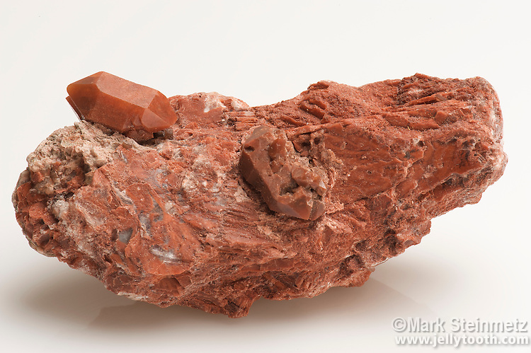 Jasper crystals on red Gypsum. Teruel, Spain. Jasper is an opaque and usually colorful variety of quartz, or silicon dioxide.