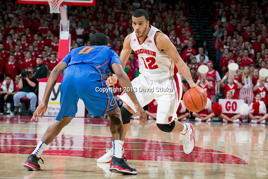 Wisconsin Badgers guard Traevon Jackson (12) handles the ball during an NCAA college basketball game against the Florida Gators Tuesday, November 12, 2013, in Madison, Wis. The Badgers won 59-53. (Photo by David Stluka)