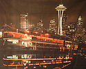 Backdrop featuring Seattle city landmarks such as the Space Needle, Pike Place Market, Ivar's and Argosy Cruise ship at waterfront