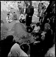Beit Lahia, Gaza Strip, Jan 15 2009.Mourning families gather over hundreds of fresh tombs in Beit-Lahia's main cemetery..