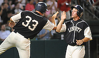 June 20, 2009: Ryan Lavarnway (33), left, congratulates Zach Gentile (7) after both Greenville Drive players scored during a game that clinched the first half Southern Division title for the South Atlantic League. The Drive took the title with a 15-3 win over the Lexington Legends at Fluor Field at the West End in Greenville, S.C. Drive players were wearing Greenville Mill League throwback jerseys that were being auctioned off after the game. Photo by: Tom Priddy/Four Seam Images