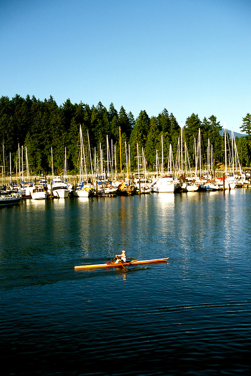 Canada: Vancouver. Sculler in boat harbor.  Photo #: cnvanc103..Photo copyright Lee Foster, 510/549-2202, lee@fostertravel.com, www.fostertravel.com