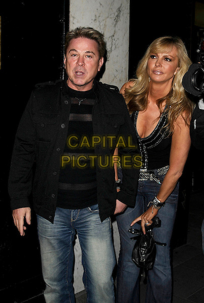 DAVID VAN DAY & SUE MOXLEY.Nikki Grahame's book launch party, Embassy nightclub, Old Burlington St., London, England..May 7th, 2009.full length 3/4 couple black jacket mouth open top cleavage jeans denim.CAP/CAN.©Can Nguyen/Capital Pictures.