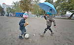 Four-year old Mashad kicks the ball to his 7-year old sister, Farah, in a city park in Belgrade, Serbia. They are refugees from Syria, and with their family fled that nation for western Europe. This park has filled with refugees from several countries stopping over on their way to Germany, Sweden, Holland, and elsewhere. <br /> <br /> Parental consent obtained.