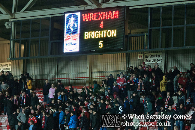 Wrexham 1 Brighton & Hove Albion 1, 18/01/2012. Racecourse Ground, FA Cup 3rd Round Replay. Wrexham fans in the Eric Roberts Building Services Stand leaving the ground after the penalty shoot out against Brighton and Hove Albion in an FA Cup third round replay, at the Racecourse Ground played following the teams one-all draw in the first match. The replay was won by Brighton, 5-4 on penalty kicks after the match had ended in a one-all draw after extra time, watch by a crowd of 8316. The visitors played in the Championship, three leagues above their rivals from Wales, who were top of the Conference at the time of the match. Photo by Colin McPherson.