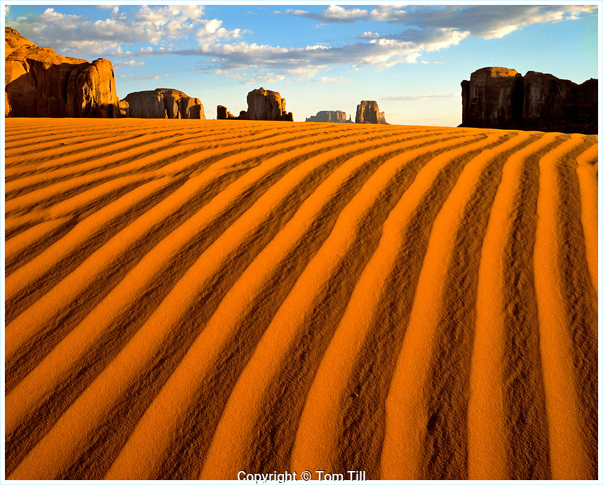 Sand dunes and monoliths, Monument Valley Tribal Park, Arizona