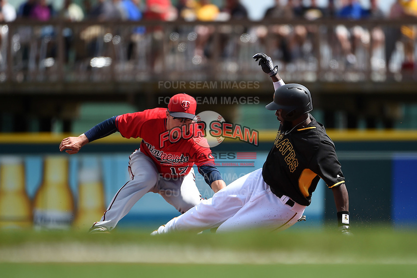 Minnesota Twins infielder Doug Bernier (17) tags Josh Harrison (5) sliding into second during a Spring Training game against the Pittsburgh Pirates on March 13, 2015 at McKechnie Field in Bradenton, Florida.  Minnesota defeated Pittsburgh 8-3.  (Mike Janes/Four Seam Images)