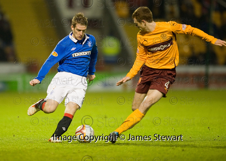 26/12/2010   Copyright  Pic : James Stewart.sct_jsp031_motherwell_v_rangers  .::  RANGERS' STEVEN DAVIS TAKES ON MARK REYNOLDS  ::.James Stewart Photography 19 Carronlea Drive, Falkirk. FK2 8DN      Vat Reg No. 607 6932 25.Telephone      : +44 (0)1324 570291 .Mobile              : +44 (0)7721 416997.E-mail  :  jim@jspa.co.uk.If you require further information then contact Jim Stewart on any of the numbers above.........