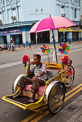 An old man waits for clients on his cycle rickshaw, a classic symbol of old Penang in capital Georgetown of Penang, Malaysia. Photo: Sanjit Das/Panos