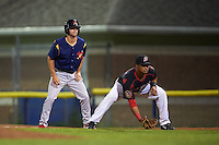 State College Spikes shortstop Champ Rowland (22) leads off behind first baseman Erwin Almonte (25) during a game against the Batavia Muckdogs August 23, 2015 at Dwyer Stadium in Batavia, New York.  State College defeated Batavia 5-3.  (Mike Janes/Four Seam Images)