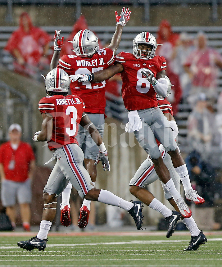 Ohio State Buckeyes cornerback Gareon Conley (8) celebrates his interception with Ohio State Buckeyes linebacker Chris Worley (35) in the 3rd quarter of their game at Ohio Stadium in Columbus, Ohio on September 10, 2016.  (Kyle Robertson / The Columbus Dispatch)