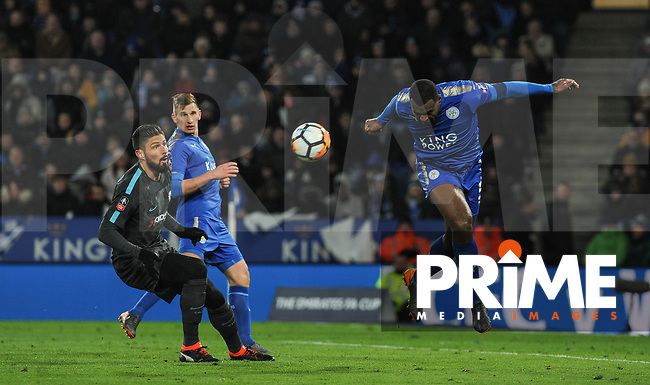 Wes Morgan of Leicester City clears from Olivier Giroud of Chelsea during the FA Cup QF match between Leicester City and Chelsea at the King Power Stadium, Leicester, England on 18 March 2018. Photo by Stephen Buckley / PRiME Media Images.