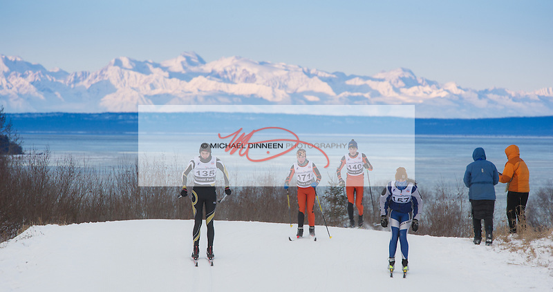 With sunrise catching the peaks of the Alaska Range behind, a quartet of skiers including Eagle River's  Kestrel Gilliam (157)  crest a hill during the Chugiak Stampede at Kincaid Park Saturday, January 16th, 2016.  Photo for the Star by  Michael Dinneen