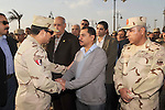 A handout picture released by the military moral affairs shows the Egypt's army chief, Field Marshal Abdel Fattah al-Sisi, speaks with relatives of the two army officers killed by a militant group, during a funeral in Cairo on March 19, 2014. Two Egyptian army officers were killed on Wednesday during a raid on militant hideouts near the Nile Delta, the Interior Ministry said. apaimages/Military Moral Affairs