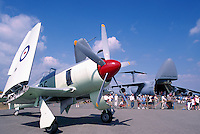 Hawker Sea Fury on Static Display - at Abbotsford International Airshow, BC, British Columbia, Canada - US Air Force Lockheed C-5 Galaxy Military Cargo Transport Aircraft in background