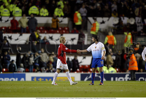 DAVID BECKHAM shakes hands with Murat Yakin, MANCHESTER UNITED 1 v FC Basel 1, UEFA Champions League Group Stage 2, Old Trafford 030312 Photo:Glyn Kirk/Action Plus...2003.Soccer Football utd hand shaking