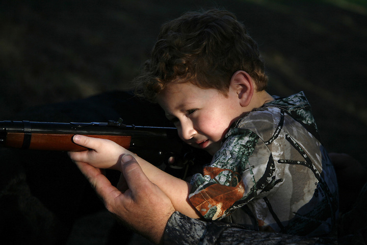 GAINESVILLE, FLORIDA, U.S.A. - JANUARY 6, 2007: Gregory Davison, age 4, accompanies his family on a dove hunt on the family farm in Gainesville, Florida. Photo by Matt May