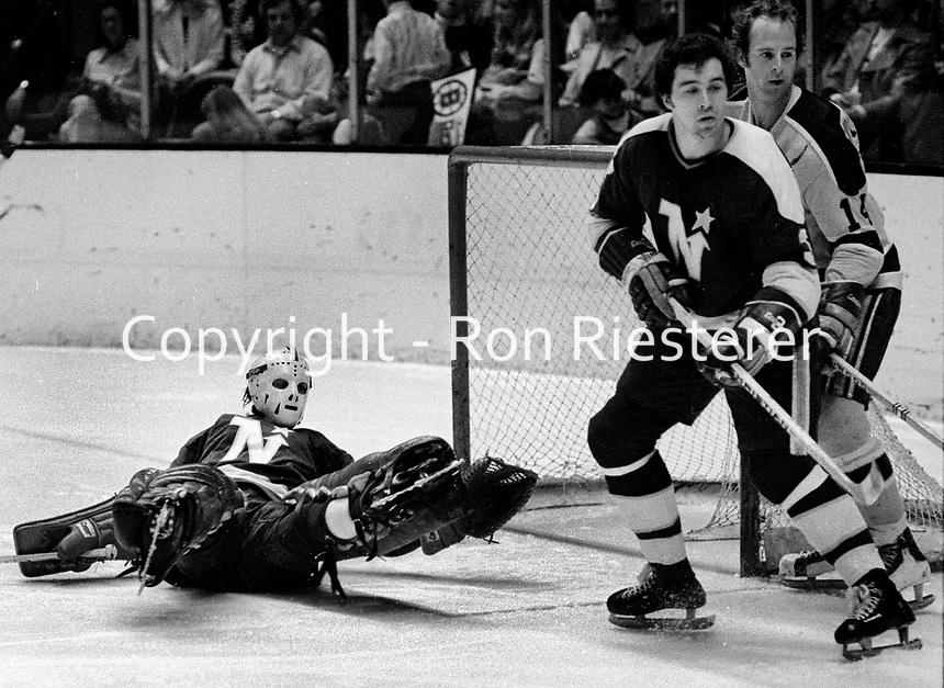 Northstar #3 Fred Barrett, goalie Gilles Gilbert, and California Golden Seals Greg Patrick..(1973 photo/Ron Riesterer)